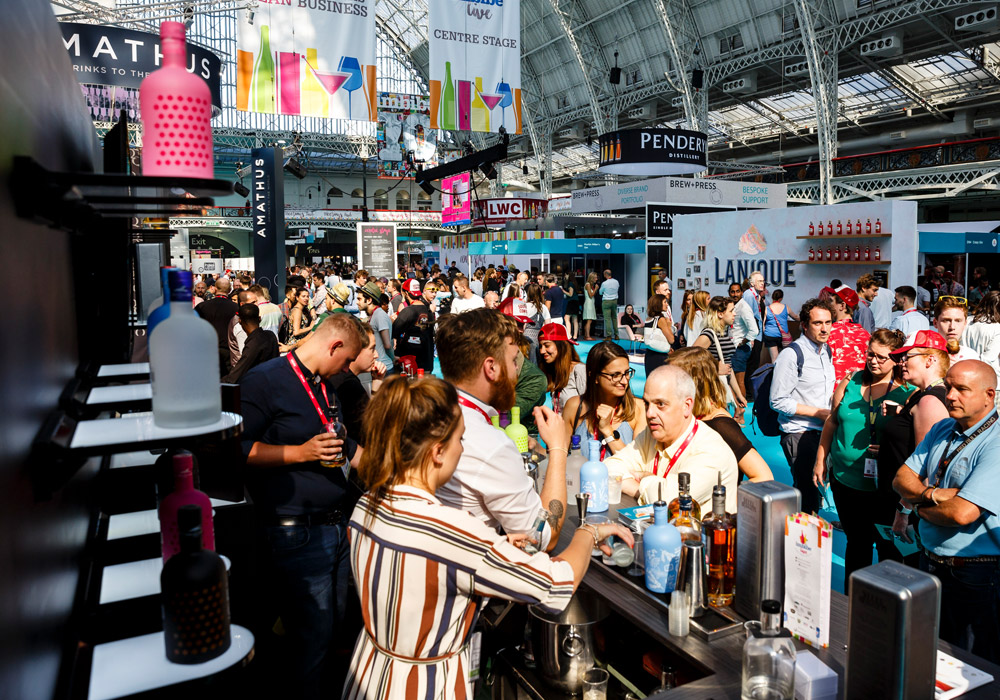 Cocktail making at busy Lakes Distillery exhibition stand at IMBIBE Olympia London