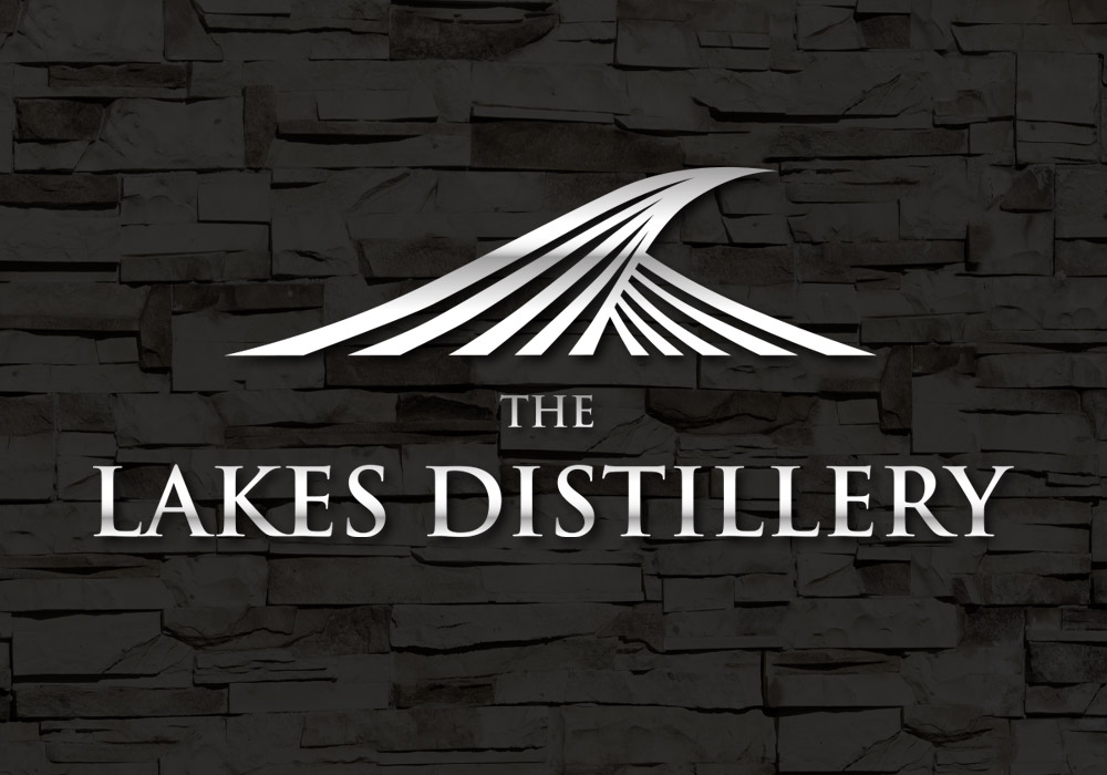 Proposed design showing The Lakes Distillery logo with metal effect mounted on black stone wall for exhibition stand