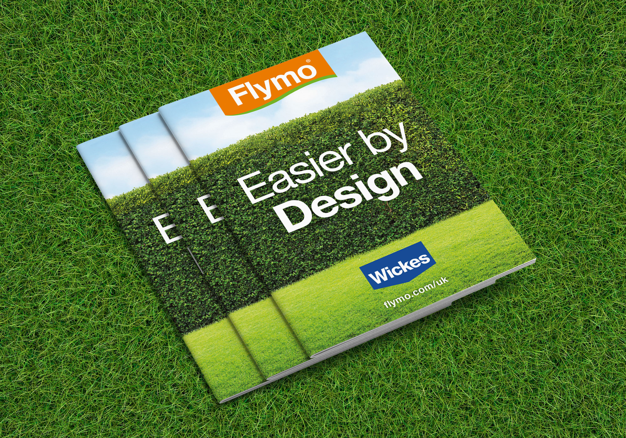 Set of Flymo product booklets on grass background