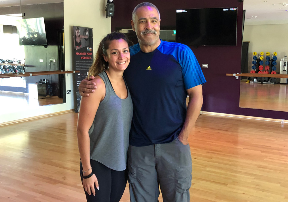 Daley Thompson posing with Caroline after training